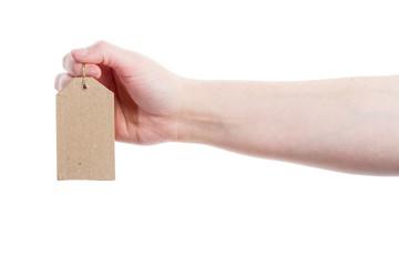 Hand holding cardboard tag