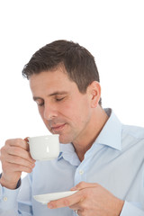 Man savouring the aroma of a cup of coffee
