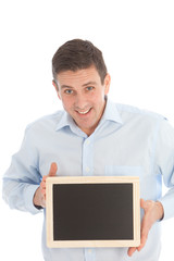 Smiling middle-aged man holding a black board