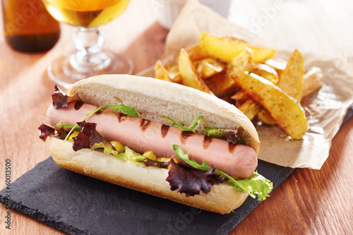Gourmet hot dog on slate board