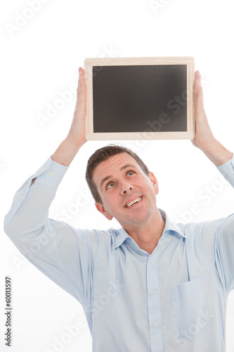 Man holding a black board above his head