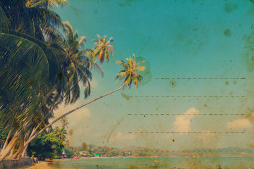 Vintage stylized post card with tropical palm trees on a beach