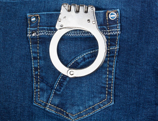 handcuffs in blue jeans pocket