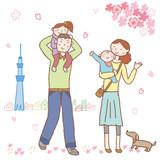 スカイツリーと散歩する家族