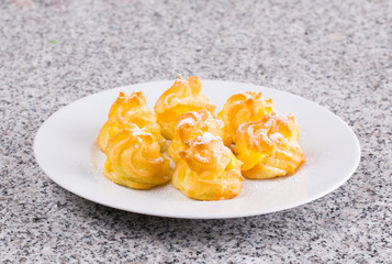 Home made cream puff on a white plate