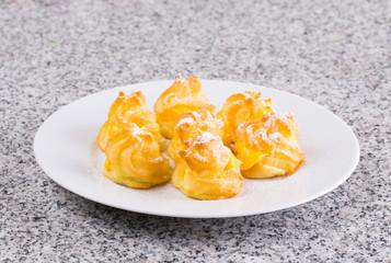 Home made cream puff on a white plate