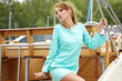 Elegant retro woman wear dress ,  near the yacht marine. 60's in