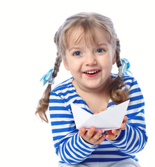 portrait of a little girl holding a paper boat on a white backgr