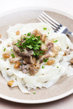 chicken, beef and pork meat with peanuts and rice noodles