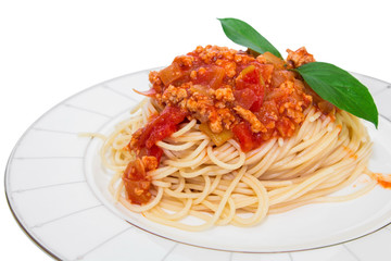 Spaghetti with tomato sauce on a plate .