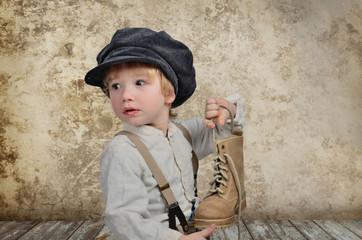Junge mit Stiefel