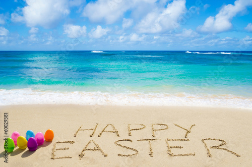 "Sign ""Happy Easter"" with eggs on the beach"