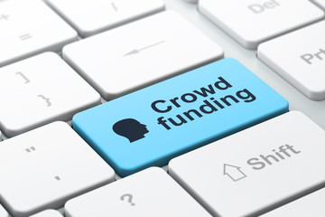 Finance concept: Head and Crowd Funding on computer keyboard