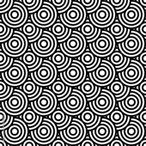 Seamless op art texture with circle elements.