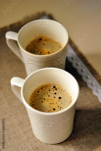 Two mugs of aromatic coffee