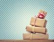 Leinwandbild Motiv Handmade gift boxes over polka dots background