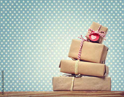 Handmade gift boxes over polka dots background