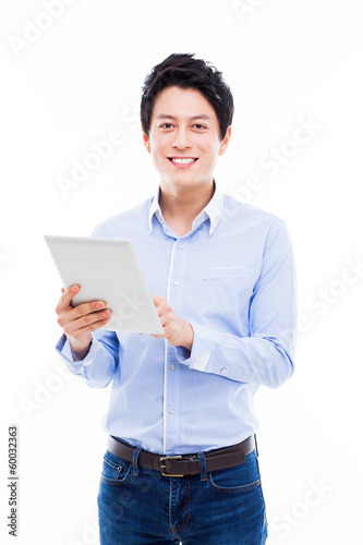 young Asian man having a smard pad PC