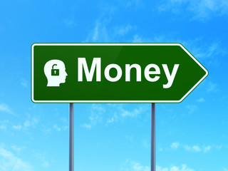 Finance concept: Money and Head With Padlock on road sign