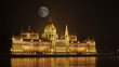 Parliament of Budapest, Hungary at night by the full moon