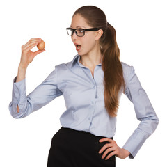 Young woman in glasses holding a chicken egg