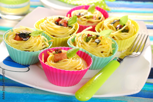 pasta nests baked in silicone muffin molds