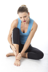 Woman Nursing Ankle Injury