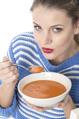 Young Woman Eating Minestrone Soup