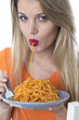 Young Woman Eating Spaghetti Pasta