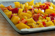 Mix red and yellow peppers cut into pieces and put into the pan.