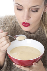 Young Woman Eating Chicken Soup