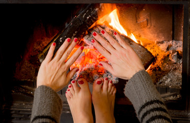 woman warming her hands ands feet
