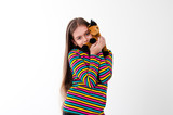 girl with long hair holding a toy horse