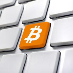 Bitcoin symbol on computer keyboard