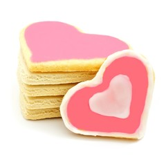 Stack of heart shaped cookies with pink frosting
