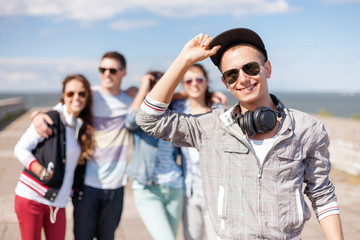 teenage boy with sunglasses and friends outside