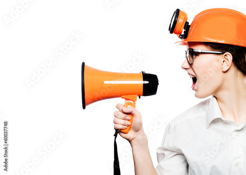 Young woman shouting in megaphone and pointing in camera