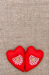 Textile hearts on the burlap
