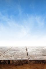 Empty table against blue sky