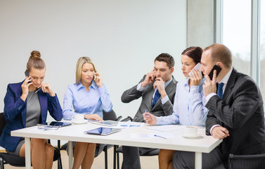 business team with smartphones having conversation