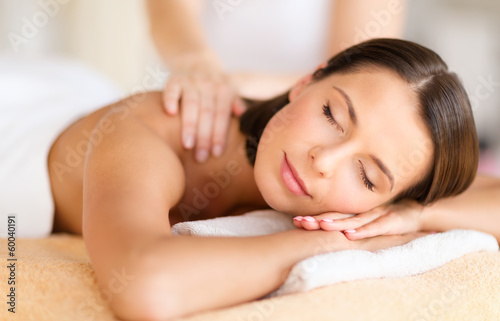 beautiful woman in spa salon getting massage
