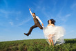 Newly married couple portrait with blue sky