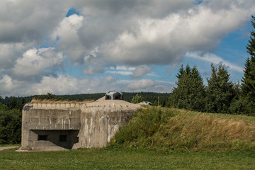 Bunker under sky with clouds