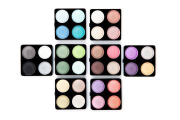 Eight eyeshadow palettes isolated on white