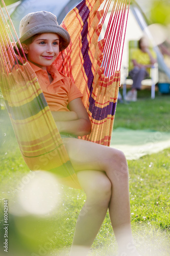Summer camp - young girl with family on the camping