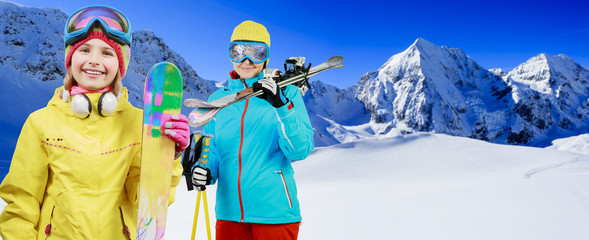 Ski, skiers - family enjoying winter vacations