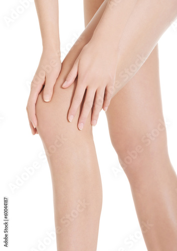 Woman's smooth knee, pampiering. Spa concept.