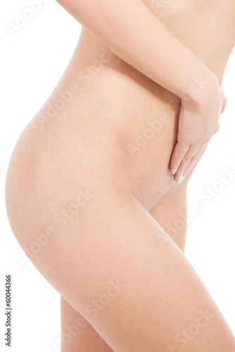 Woman's flat belly. Slim figure.