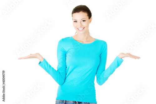 Young beautiful casual woman has empty space on her palms.