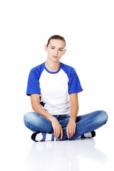 Beautiful young teenage woman sitting.